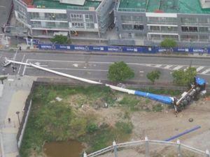 One man dead, teen critical after Brisbane crane collapses