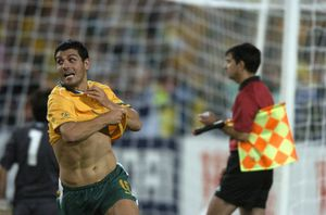 Australia's John Aloisi celebrates after scoring the final ball in a shoot out to defeat Uruguay at Telstra stadium in Sydney, Wednesday, Nov. 16, 2005.