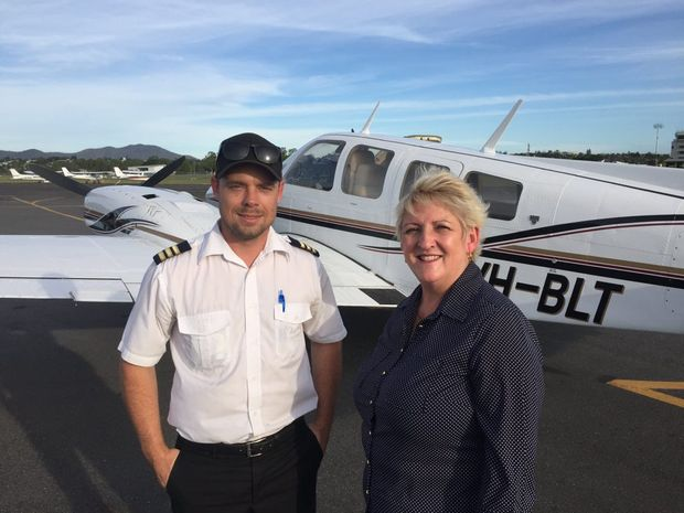 Pilot Stephen Alley and Michelle Landry on safe ground.