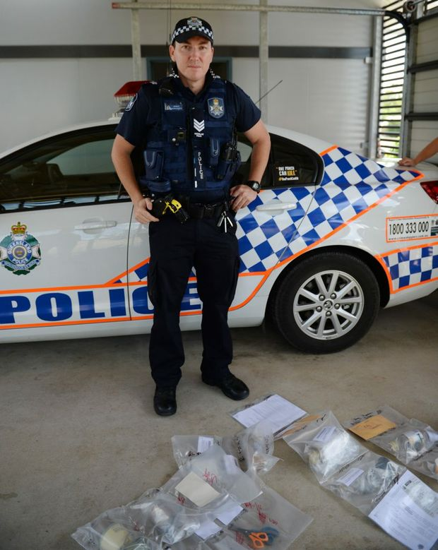 Sergeant Anthony Houston at Gracemere police station with some of the items found in drug raids today.. Photo Allan Reinikka / The Morning Bulletin