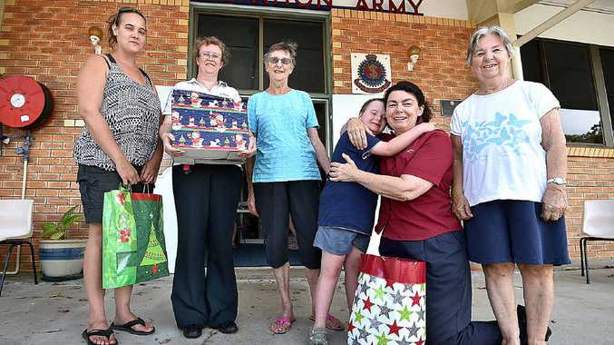 (L) Rebecca and her nine-year-old son Josh, receive a hamper from The Salvation Army. Lieutenant Adele Williams, Bev Venaglia, Major Lyn Cook and Doreen Stibbe watch on.