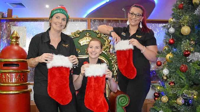 MERRY CHRISTMAS: Reef Gateway Hotel staff members Nat McCarthy, Joanna Hunter and Jade Pope.