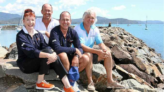 ACT OF GENEROSITY: Peter Greste (centre) with his brother Andrew and bareboat operators Annie Judd (Charter Yachts Australia) and Trevor Rees (Whitsunday Escape) who gave the Greste family a Whitsunday trip.