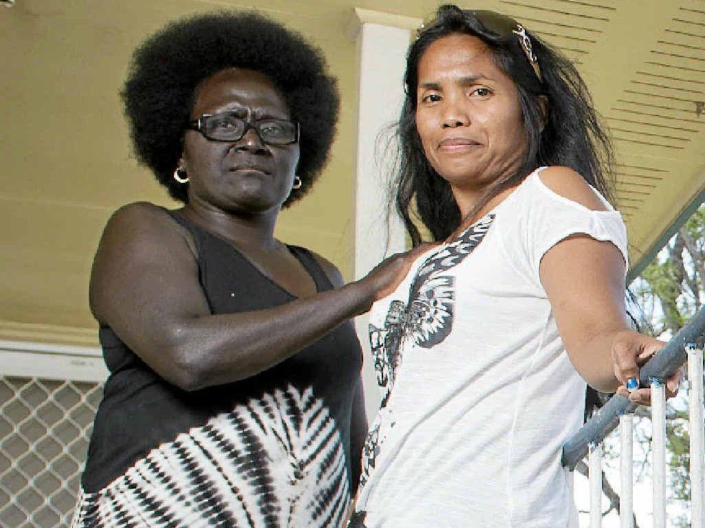 GRIM CHRISTMAS: Agatha Powell comforts Susie Latumahina, who had her handbag stolen on Monday.