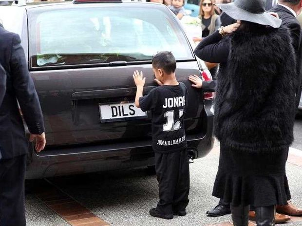 Widow of Jonah Lomu, Nadene Lomu and her two sons, Brayley Lomu (R, behind his mother) and Dhyreille Lomu (L) at the Funeral Service for Jonah Lomu at The Church of Jesus Christ of Latter-Day Saints on December 01, 2015 in Auckland, New Zealand. Ex-Rugby and All Black Player Jonah Lomu died on the 18th of November 2015 at the age of 40.