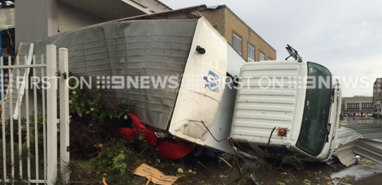 A truck has flipped in destructive winds that have moved through Kurnell.