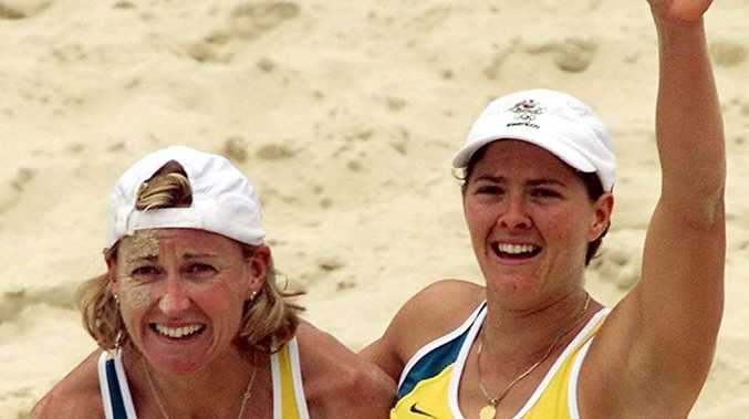 Australia's Kerry Pottharst, left, and Natalie Cook, right, celebrate their gold medal victory in women's beach volleyball after they defeated Brazil's Shelda Bede and Adriana Behar in Sydney. Photo: AP Photo/Laurent Rebours.