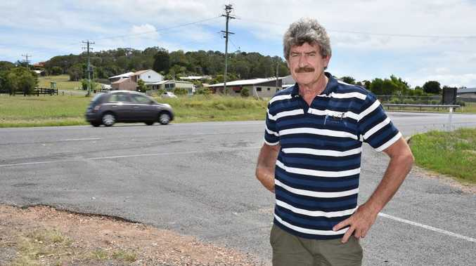 Greg Harding - owner Craignish Country Club with Pialba Burrum Heads Rd behind him where a fatal accident happened. Photo: Alistair Brightman / Fraser Coast Chronicle