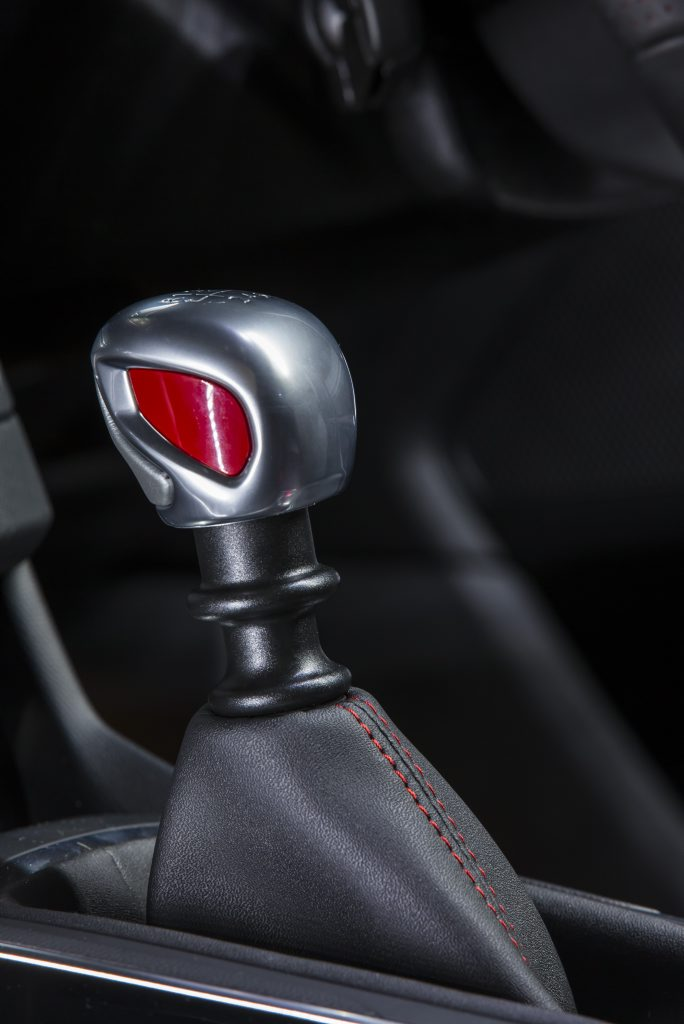 WELL BRANDED: Metal gear knob looks the part, but leave the car in the sun too long and you'll be burning your palm.