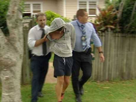 Police take a man they believe is behind a spate of offences in Toowoomba into custody.