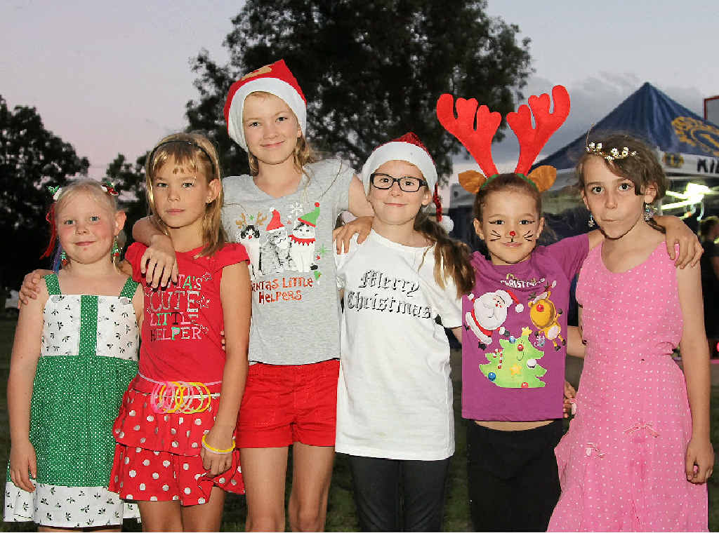 SANTA'S HELPERS: Ashley Petersen, Krystal Petersen, Casey Fagg, Amy Beck, Shelby Giblin-Lloyd and Lizzy McMullan at the Killarney event last year.