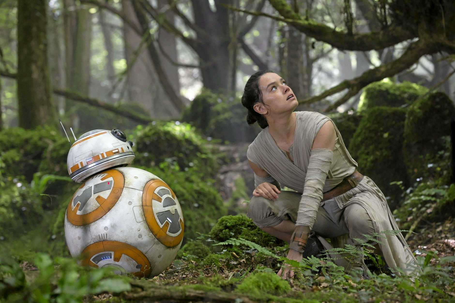 The character BB-8 and Daisy Ridley in a scene from Star Wars: The Force Awakens.