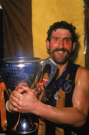 Robert DiPierdomenico of Hawthorn celebrates with the Premiership Trophy in the rooms after winning the 1986 VFL Grand Final against Carlton. (Photo by Getty Images).