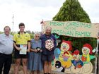 Mayor Peter Maguire presenting the Spirit of Christmas award to Flynn, Eileen and Micheal Brosnan. Photo Matty Holdsworth / CQ News