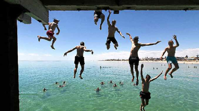 CHILL THRILLS: Jetty jumpers escape the heat at Henley Beach near Adelaide.