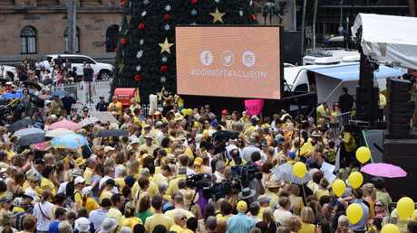 Brisbane's King George Square is awash with yellow as community members protest family violence in light of Gerard Baden-Clay's murder charge being downgraded after he killed wife Allison