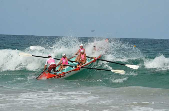 SPLASH AND DASH: The Woolgoolga boat takes a wave at the Hawks Nest carnival.