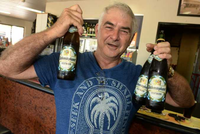 ACCEPTING THE CHALLENGE: The Bundaberg Beer Drinking Champions' president Ross Walker with the beer of choice for the week. Photo: Mike Knott / NewsMail