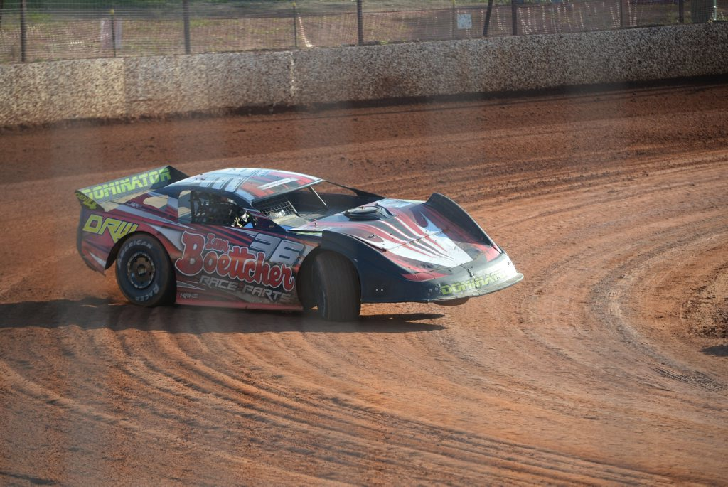 ON THE EDGE: Darren Kane completes the bend on three wheels at Carina Speedway. Photo: Paul Donaldson / NewsMail