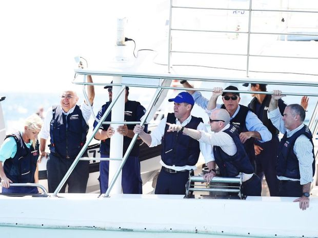 NSW Premier Mike Baird journeyed out onto the ocean to witness the new drum line be deployed along the Ballina coast line. Photo Marc Stapelberg / The Northern Star