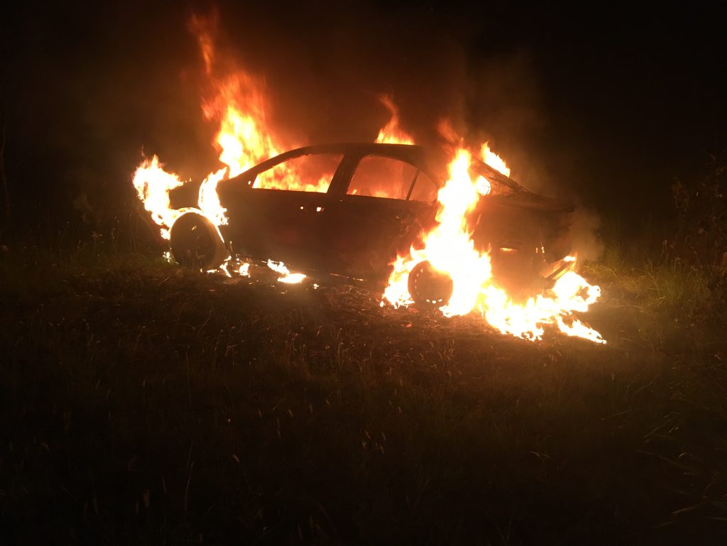 A red Mitsubishi Lancer was destroyed by fire Friday night.