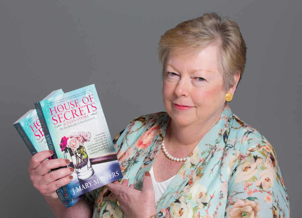 Judy Hinz, writing as J Mary Masters, with debut novel House of Secrets.