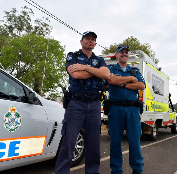 EXTRA MILE: Spare a thought for Roma pair Sgt Troy Newman and paramedic Shayne O'Neil, who will be working on Christmas Day.