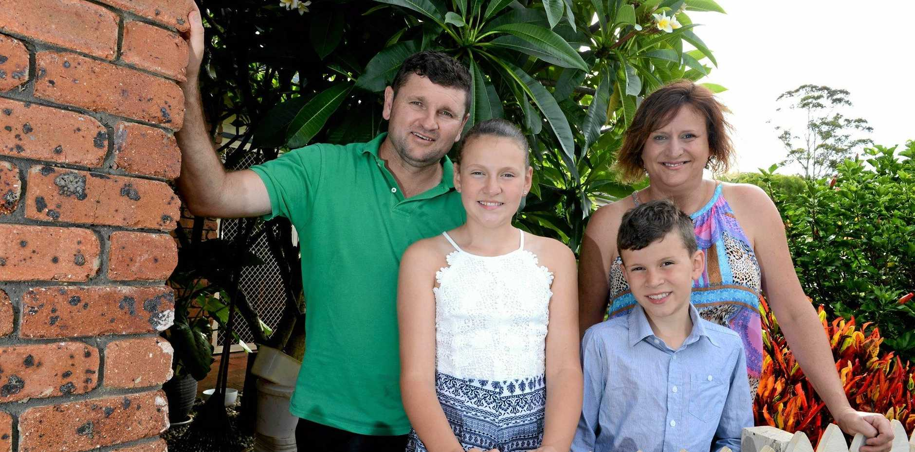 Mia Johnson, 11 of Goonellabah, with her family, Brad, Christie, and Kahn, 9. Mia is in  remission from a rare cancer. She and her family are supported by the Children's Hospital Foundation.Photo Cathy Adams / The Northern Star
