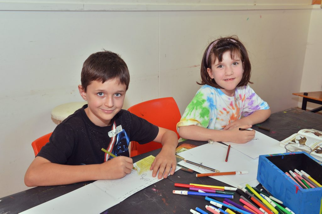 Learning to create artistic books during an earlier holiday fun activity at the Gympie Regional Gallery are brother and sister Darcy and Jessica Hourigan.
