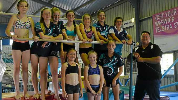 EXPANDING HORIZONS: Gymnasts (back) Ella Murphy, Demi Eather, Lillie Clarke, Shaye Campbell, Amber Hentschel, Lara Walker, Imogene Davidson (front) Steph Lyons, Mikayla O'Neill and Christie Lyons and president Coby Walker welcome a Queensland Government grant to build a new shed.