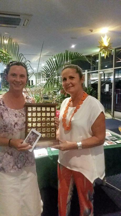 LOCAL CHAMP: Women's Golf Casino club champion Jacki Bratti, left, takes her trophy from Debbie Low.