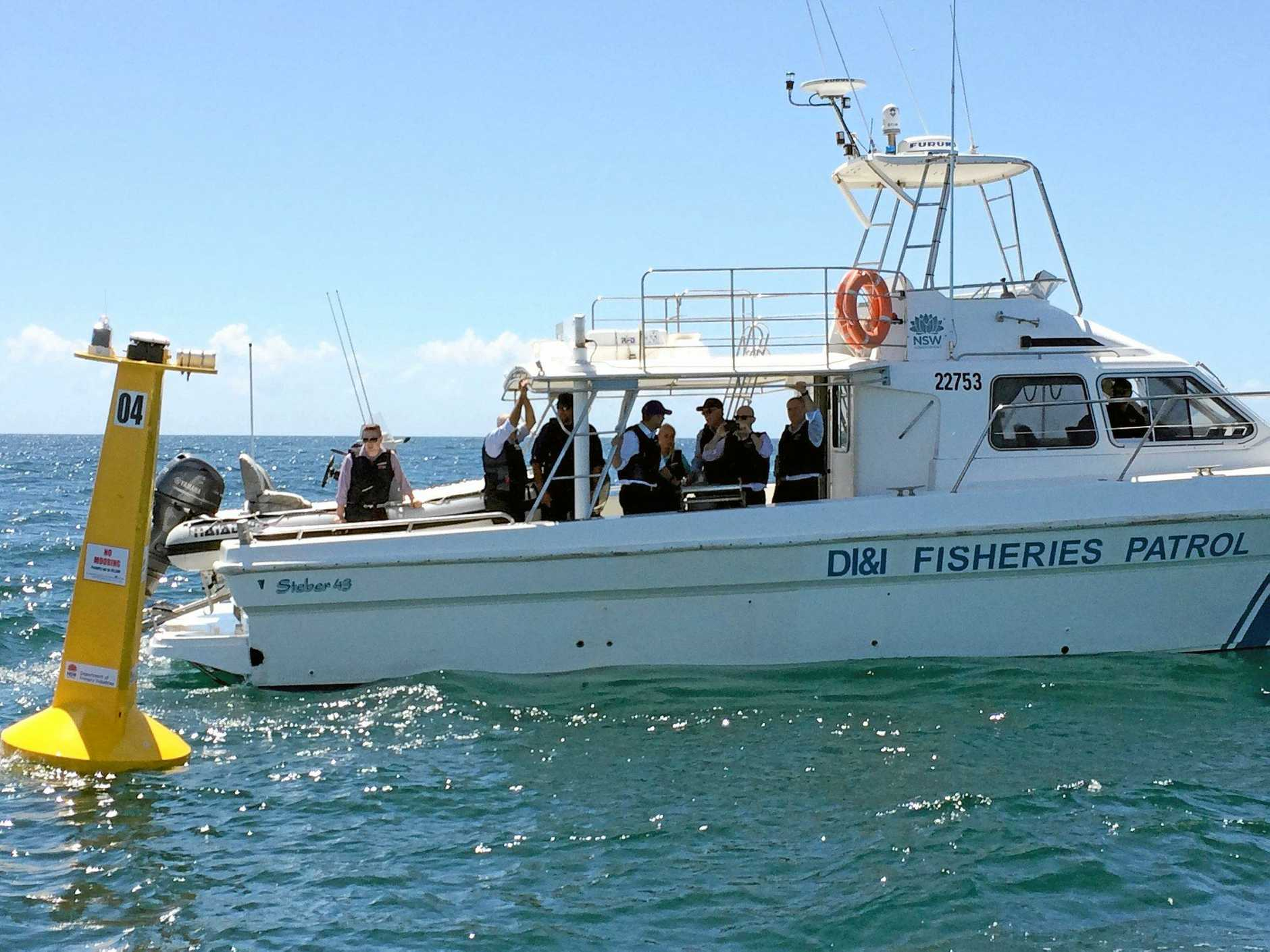 Premier Mike Baird with the DPI inspecting listening station off Lennox Head.Photo Leah White / The Northern Star