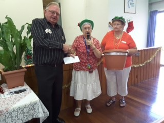 Secretary Margee Ellis and President Irma Steffens presenting cheque to Mr Phillip Charles of Toowoomba Rotary with Cheque for $1500