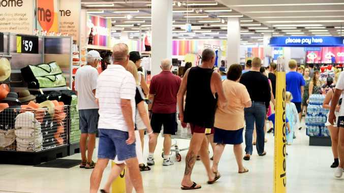 GRABBING BARGAINS: Shoppers walk into at Stockland's Kmart to buy a bargain.