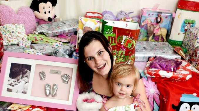 A tough year -There was going to be no Christmas for Stacey Allwood and her little family, until secret santa donations started arriving. Photo: Valerie Horton / Fraser Coast Chronicle