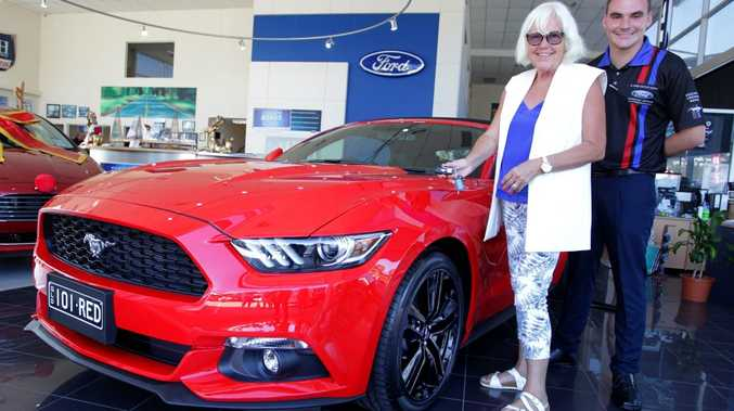 Elly Lenz from Kureelpa with her new Ford Mustang at Pacific Ford, Maroochydore, the first of the 2016 models to be delivered on the Sunshine Coast by Alister Eiseman. Photo: Iain Curry / Sunshine Coast Daily