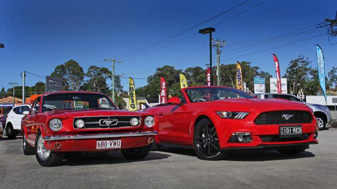 (left) Steve Dunsmuir's 1965 Ford Mustang GT Coupe with the new 2016 Ford Mustang at Pacific Ford, Maroochydore. Photo: Iain Curry / Sunshine Coast Daily