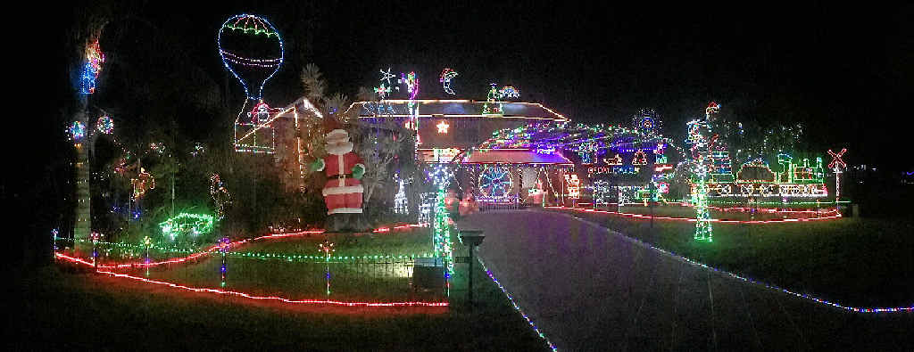 MERRY WONDERLAND: The Kammholz home delights all with its colourful and very Aussie Christmas lights.