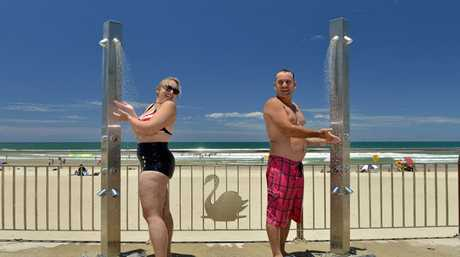 Fiona Herbert and Darren Boyd from Canberra cooling off at Marochydore Beach.