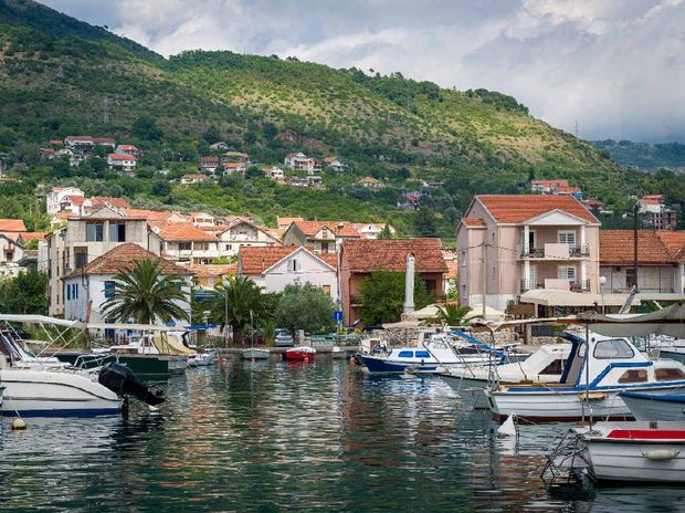 Traditional boats at a fishing village in Montenegro.
