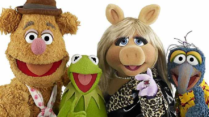 Characters Fozzie Bear, Kermit the Frog, Miss Piggy and Gonzo from The Muppets.