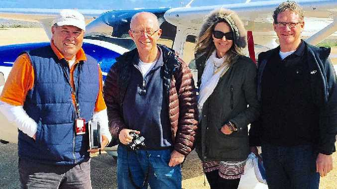 EXPLORING THE OUTBACK: Checking out Alice Springs are (from left) Mark Westcott, raffle organiser Herbie Rosenberg, passenger Sarah Cox and Toowoomba man Tom McVeigh.