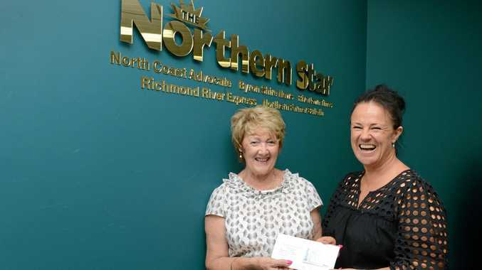 GOOD GIFT: One of the winners of The Northern Star's Cashed Up for Christmas giveaway, Leona Ross of East Ballina, and sales executive Leanne Cawley.