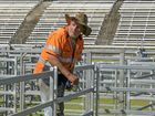 LOOKIN' GOOD: Bruce Green checks out the structure of the rodeo ring at the Maclean Showground in front of what will be a packed grandstand for the Maclean Twilight Rodeo.