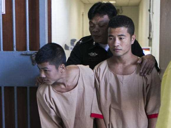 Myanmar migrants Win Zaw Htun, right, and Zaw Lin, left, both 22, are escorted by officials after their guilty verdict at court in Koh Samui, Thailand, Thursday, Dec. 24, 2015. A Thai court on Thursday sentenced the two Myanmar migrants to death for killing British backpackers David Miller, 24, and Hannah Witheridge, 23, on the resort island of Koh Tao last year.