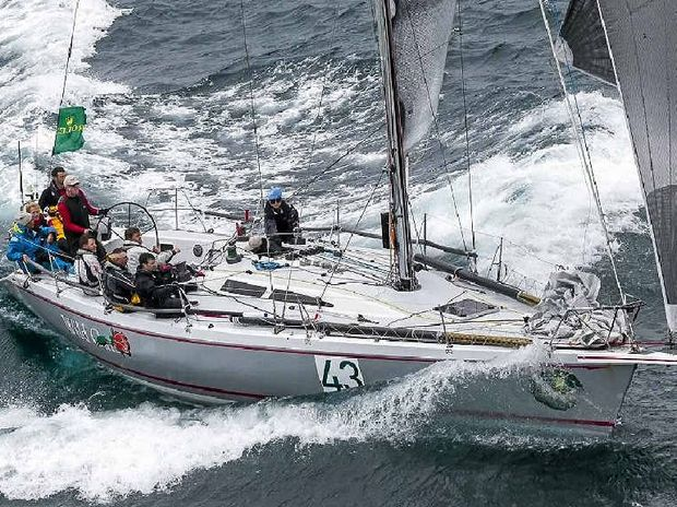 RIDING SOUTH: Wild Rose moves rapidly towards Hobart in the last edition of the Sydney to Hobart Yacht Race. Sunshine Coast sailors Andrew and Samantha Scott will be aboard and are intent on defending handicap honours.