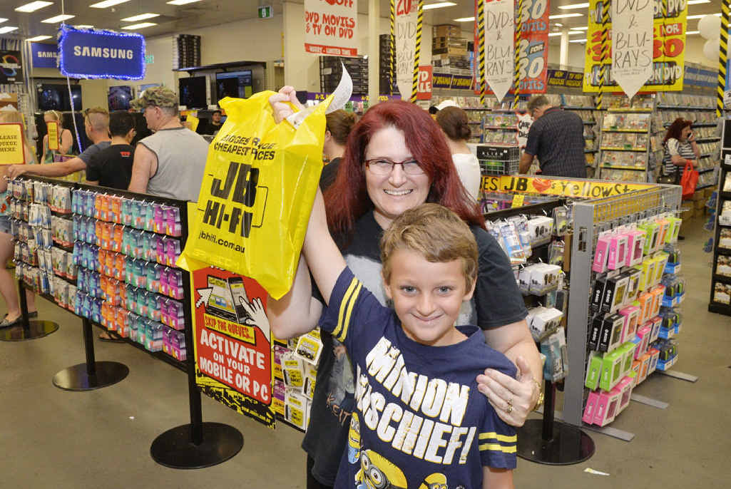 HOLIDAY FUN: Tracey and Kyle Eastell, 9, look for a bargain at JB Hi-Fi.