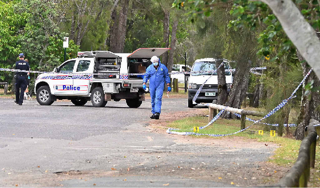 HUNT FOR CLUES: Police mark out the scene of the fatal stabbing at Tewantin yesterday.