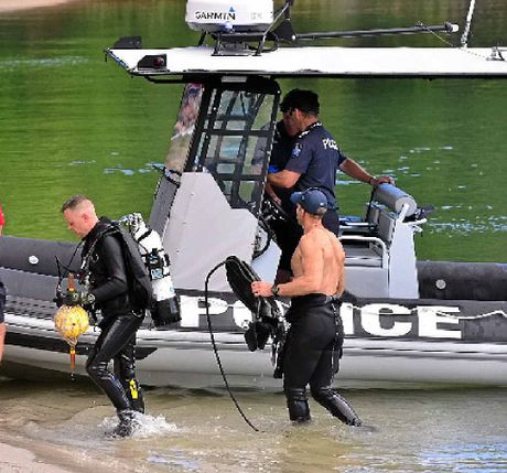 TOUGH GIG: Police divers resume their search yesterday.