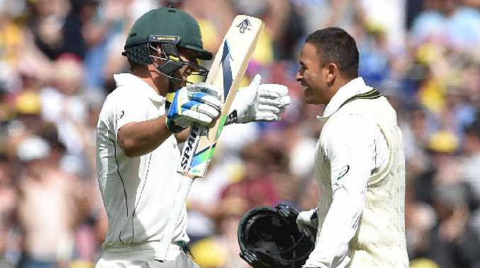 WINDIES A WALKOVER: Century-makers Joe Burns and Usman Khawaja celebrate their achievements on the opening day of the Boxing Day Test in Melbourne.